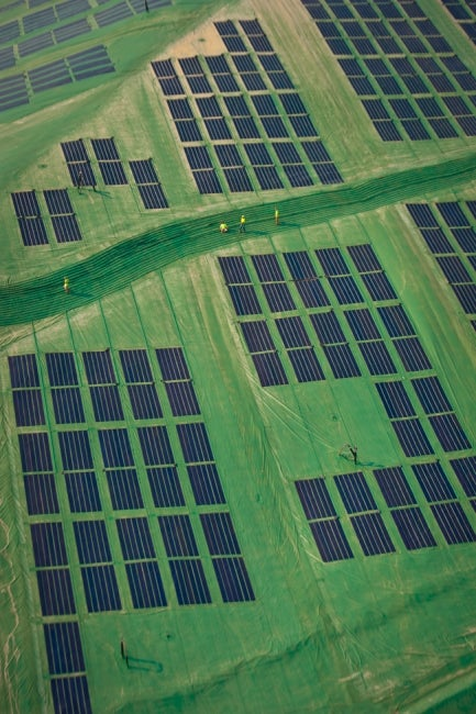 aerial close up view of landfill solar energy cover