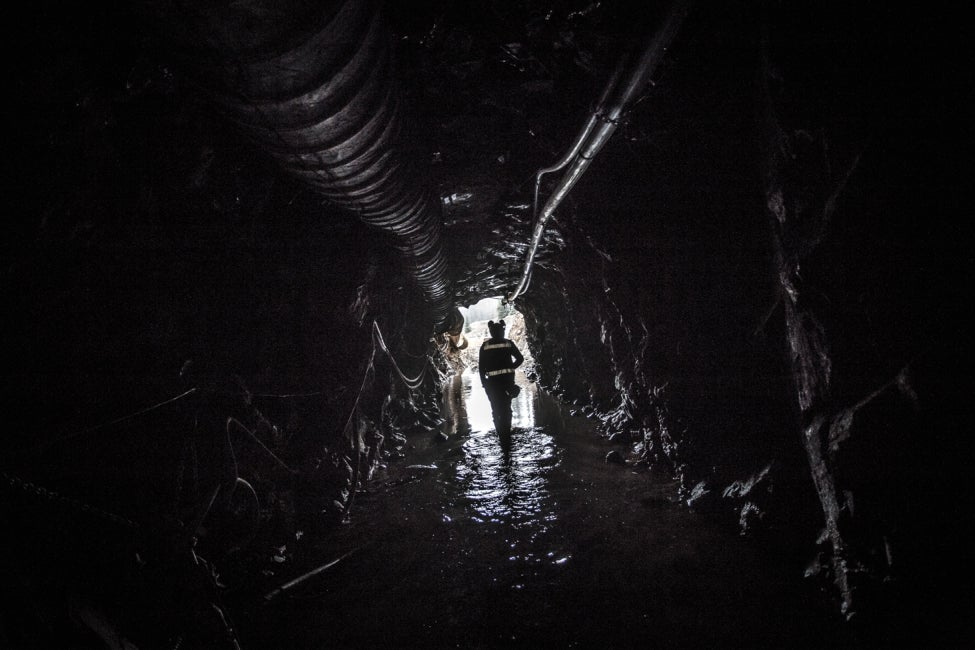 team member walking down mine shaft