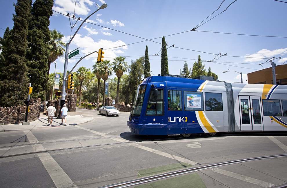 Sun Link Streetcar about to travel over crosswalk