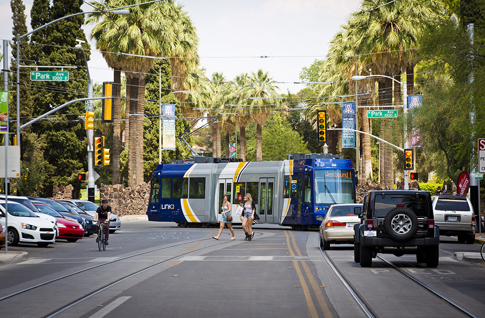 Sun Link Streetcar on street with cars, bikes and pedestrians
