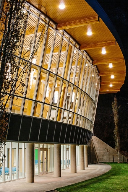 RockRidge Canyon Clubhouse exterior curved atrium nighttime