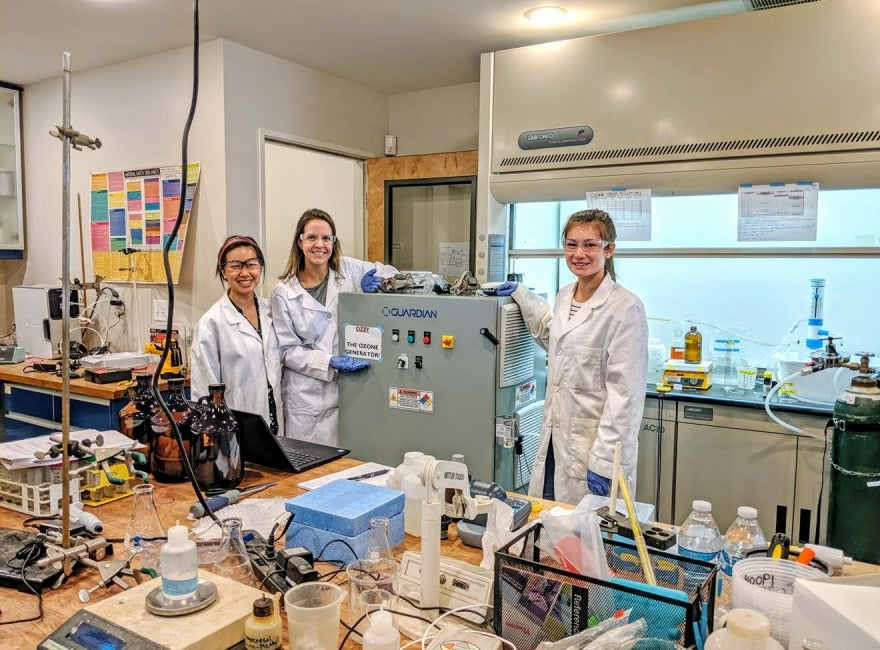 3 women working in one of HDR's One Water Institute labs