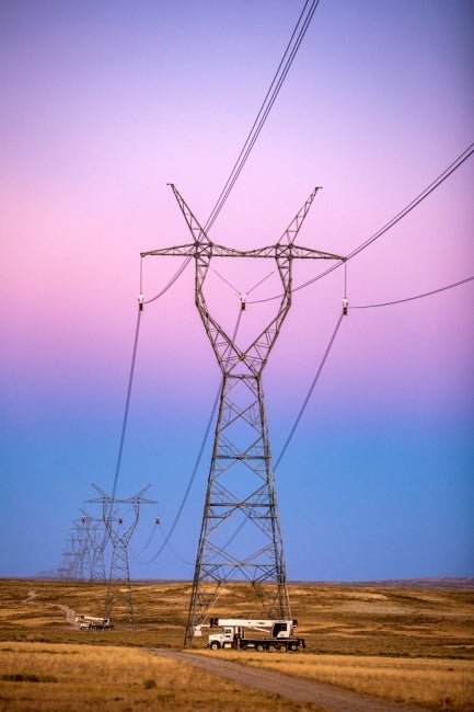 portrait image of gateway west transmission lines at dusk