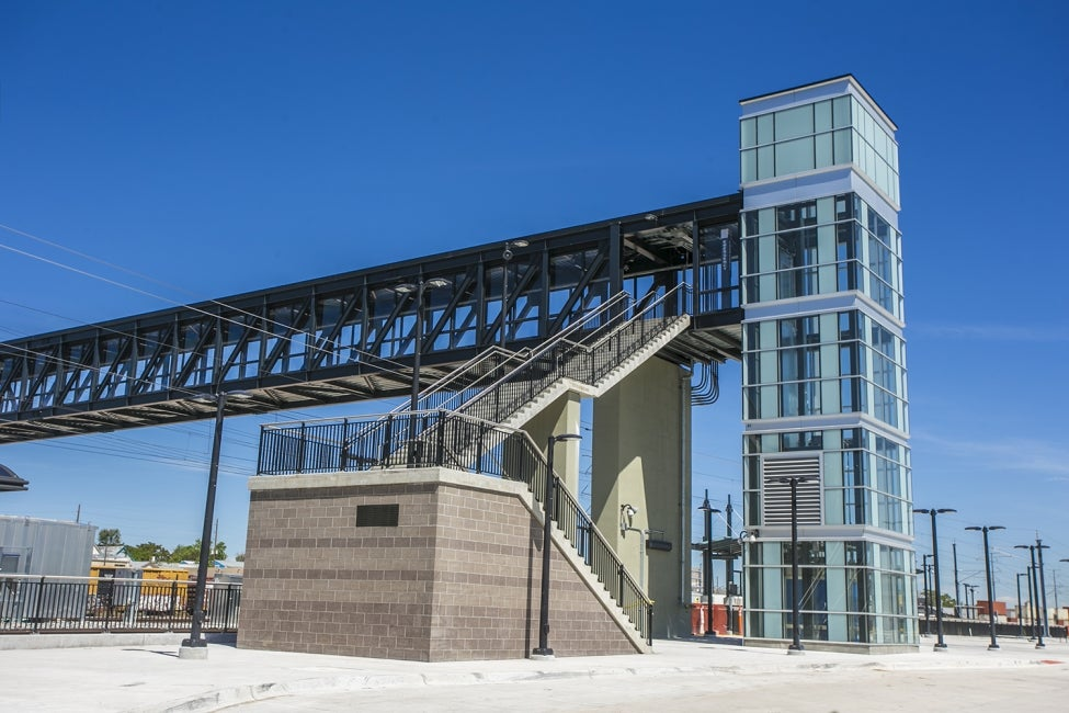 A soaring elevator tower and walkway offer universal access across tracks at 41s