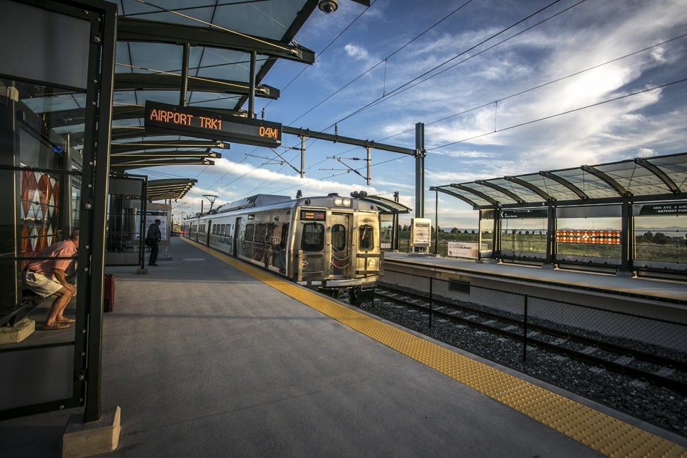 A University of Colorado A Line train arrives at one of six stations between Den