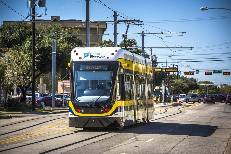 Dallas Streetcar recharges its hybrid power source by operating on an overhead c