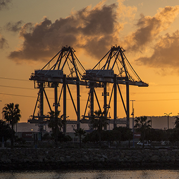 Port of Long Beach cranes at sunset