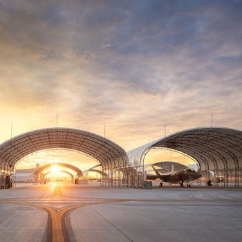 aircraft shelter at sunset